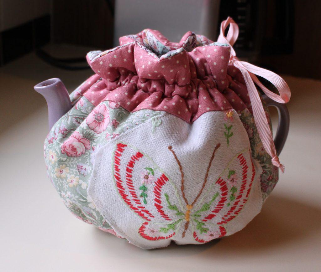 teapot cozy wrapped around pot